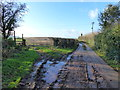 SO4904 : Road and stile to footpath, Trelleck Cross by Ruth Sharville