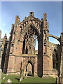 NT5434 : Melrose Abbey: east window by Jonathan Hutchins