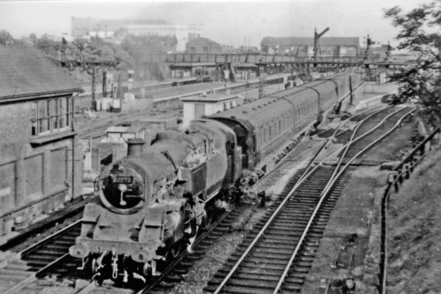 Eastward to Barking Station from A124 bridge, with Up train to Fenchurch Street, 1955