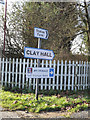 TM1039 : Clay Hall & Station Farm signs by Geographer