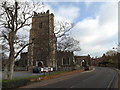 TM4656 : A1094 Victoria Road & St.Peter & St. Paul's Church by Adrian Cable