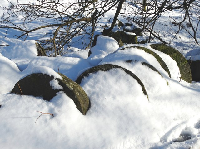 Abandoned millstones in the snow