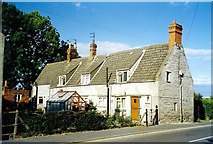 TF1020 : Old cottages in Spalding Road, Bourne, Lincolnshire by Rex Needle