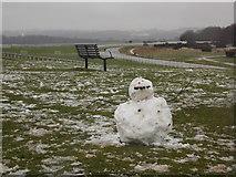 TQ2258 : Epsom: snowman and bench at Tattenham Corner by Chris Downer
