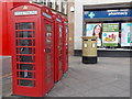 TQ0584 : Uxbridge: red telephone boxes by the station by Chris Downer
