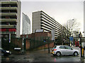 TQ3278 : Heygate Estate, corner of Rodney Place and New Kent Road in a heavy shower by Robin Stott