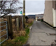 SN9803 : Public footpath sign at the edge of residential Cwmdare by Jaggery