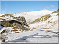 NY3408 : Frozen bog and pool north of Alcock Tarn by Trevor Littlewood