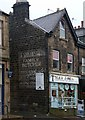 "SE1147 : ""Ghost sign"", Leeds Road, Ilkley by Julian Osley"