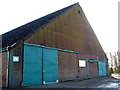 TG3805 : Big shed beside Manor Road (B1140) by Evelyn Simak