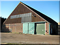 TG3804 : Big shed beside the B1140 road by Evelyn Simak