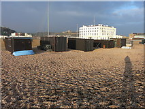 TR3140 : Fishermen's huts on a shingle beach by John Baker