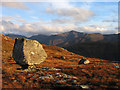 NN0649 : Perched boulder on west ridge of Beinn Fhionnlaidh by Trevor Littlewood
