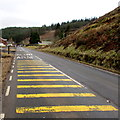 SS8596 : Yellow strips on Brytwn Road near Cymmer by Jaggery