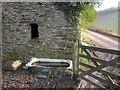 SX8353 : Bath by the bridleway, Capton Mill by Derek Harper