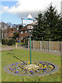TG2916 : Wroxham village sign by Adrian S Pye