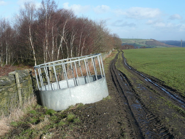 The Calderdale Way passing a circular cattle feeder