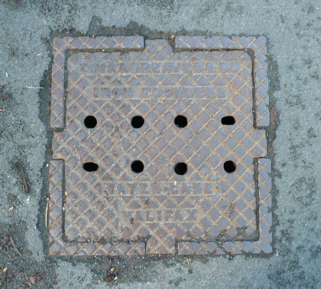 Locally-made manhole cover in Washer lane, Skircoat