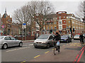TQ3379 : Cyclists on Tower Bridge Road by Stephen Craven