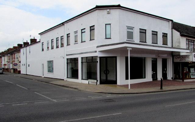 Empty white shop on a corner in Even Swindon