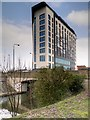 SJ8096 : Bridgewater Canal, Sir Matt Busby Way Bridge and Hotel Football by David Dixon