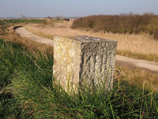 Concrete marker block on seawall
