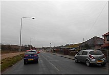 SD4764 : Traffic lights on the A6 for construction of the M6 Heysham link road by Steve  Fareham