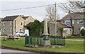 NZ1010 : War memorial with houses in Newsham by Trevor Littlewood