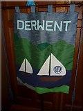 NY2623 : Keswick St John: banner (1) by Basher Eyre