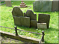 SK6929 : Hickling Churchyard - group of headstones by Alan Murray-Rust