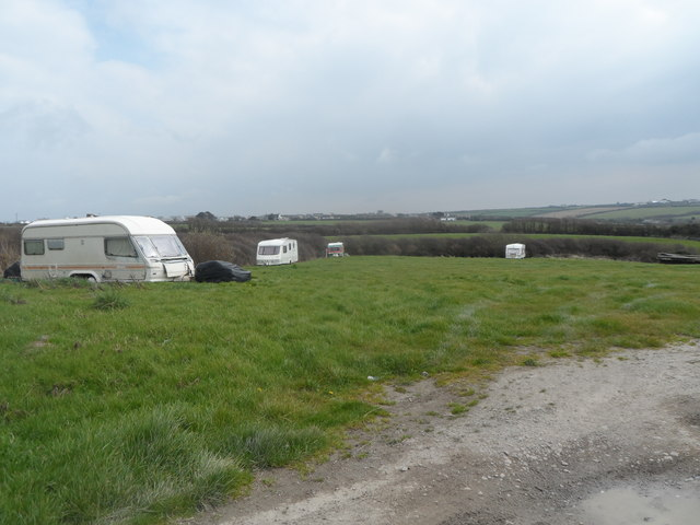 Field with scattered semi-derelict caravans