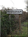 TM0668 : Finningham Village Name sign by Adrian Cable