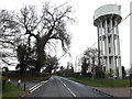 TM0668 : B1113 Station Road & Cotton Water Tower by Geographer