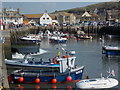 SY4690 : West Bay: the River Brit emerges into the harbour by Chris Downer