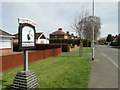 TF6019 : West Lynn village sign in St. Peter's Road by Adrian S Pye