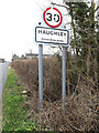 TM0362 : Haughley Village Name sign on Station Road by Geographer
