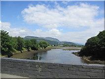 SH5738 : Afon Glaslyn flowing under Britannia Bridge (A497) by Peter Holmes
