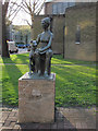 TQ3478 : Woman and dog sculpture, Avondale Square by Stephen Craven