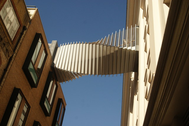 View of the twisted walkway between two buildings on Floral Street