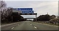 SJ6782 : Motorway signs and footbridge by John Firth