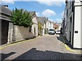 TQ2579 : Rear access road, Adam and Eve Mews by Christine Johnstone