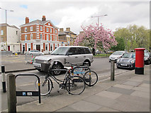 TQ4077 : Cycle rack outside the Royal Standard post office by Stephen Craven