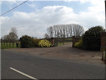 TM1573 : Entrance to Church Farm by Adrian Cable