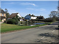 TL5528 : Pond by Henham High Street by Hugh Venables