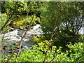NS8782 : River Carron, broken weir by Robert Murray