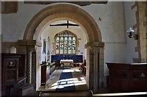 SK8707 : Egleton: St. Edmund's Church: The Norman chancel arch and chancel beyond by Michael Garlick