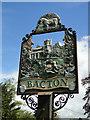 TM0567 : Bacton village sign (detail) by Adrian S Pye