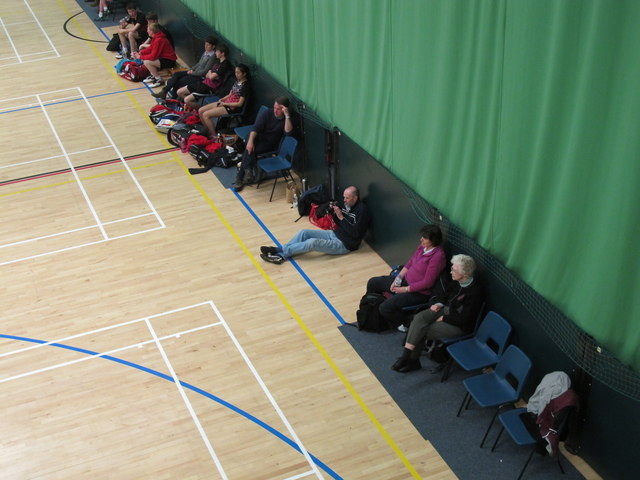 Spectators beside court, badminton Shires League U17 final