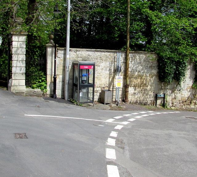 Grey phonebox on a corner in Freshford