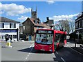 TQ1369 : Bus in Hampton Village by David Dixon